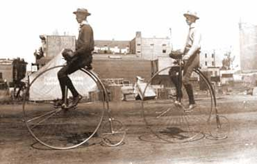 Victorians Riding Penny Farthings
