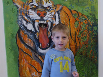 Young boy with donation tiger at museum
