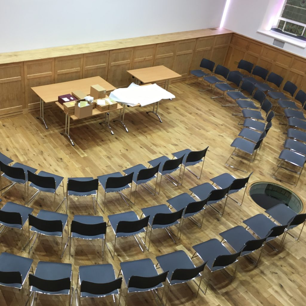 rausing building with chairs set out in concert style